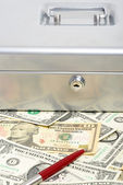 Money and cash box — Stock Photo