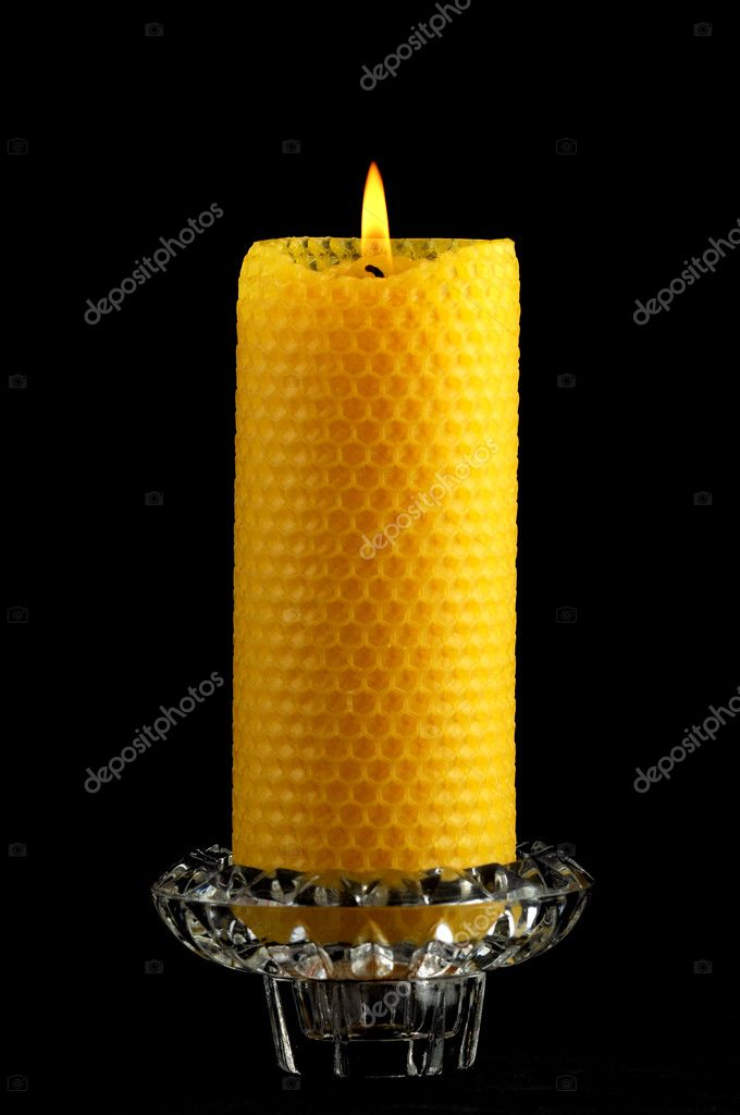 Beeswax candle in front of a black background — Stock Photo #11814422