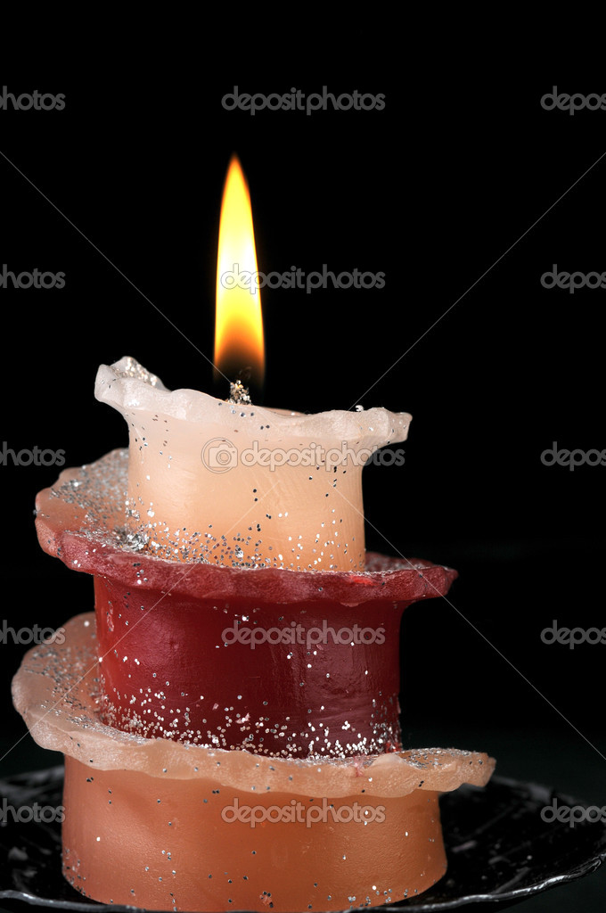 Candle in front of black background — Stock Photo #11814425