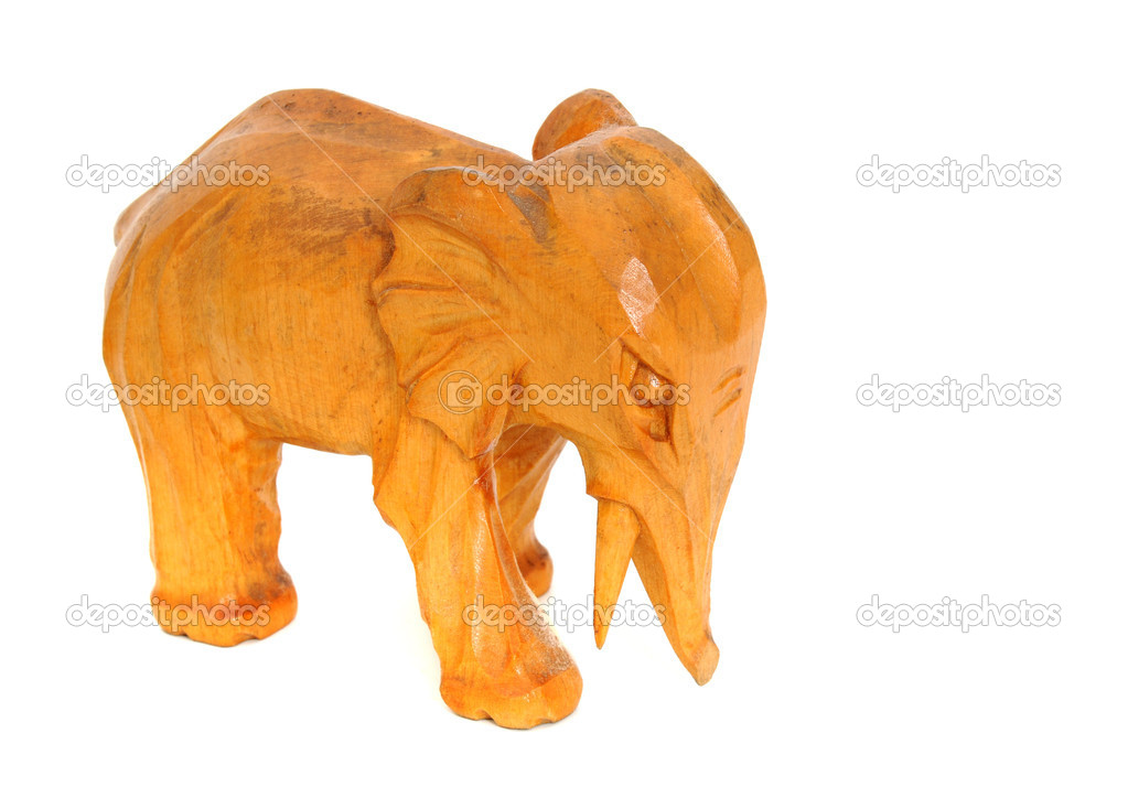 Hand-carving of an elephant on front of a white background  Stock Photo #11814956