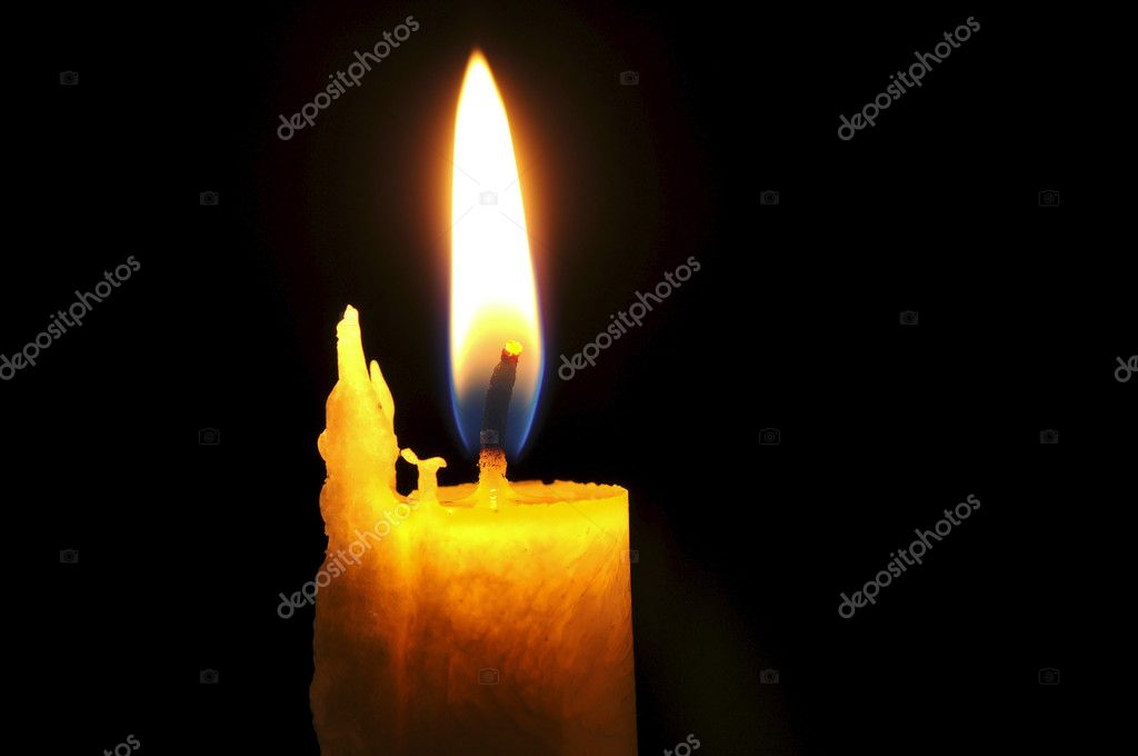 Candle in front of black background  Stock Photo #11965764