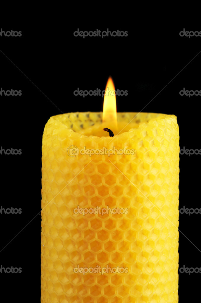 Beeswax candle in front of a black background — Stock Photo #11966167