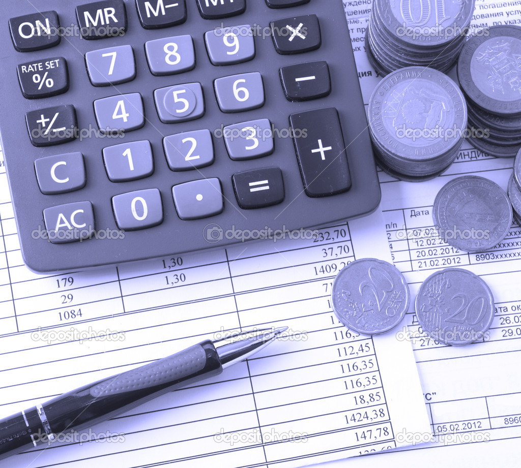 Coin A Calculator A Pen On The Business Papers Stock