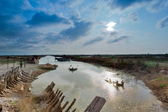 Discarded wooden boats and blue sky — Stock Photo