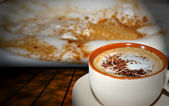 Cup of cappuccino with cocoa — Stock Photo