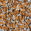 Cigarettes butts background — Stock Photo