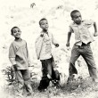 Stock Photo: Ethiopiboys jump smiling for camera