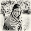 Ethiopiwomwatches straight and smiles to camera — Stock Photo #11875045