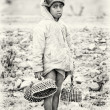 An Ethiopian girl carries hats in her hands — Stock Photo #11875379