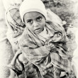 An Ethiopian watches attentively on the camera — Stock Photo