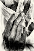 An Ethiopian woman covers her face with her hand — Stock Photo