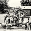 A group of Benin near the well waiting for the turn to get the water — Stock Photo