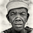 A Benin old lady watches attentively — Stock Photo
