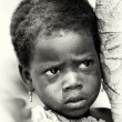 A Benin little girl watches attentively — Stock Photo