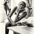 Stock Photo: Benin girl watches at somebody
