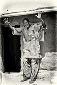 A Benin old man smiles and poses — Stok fotoğraf