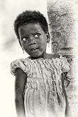 A Benin young girl watches carefully — Stock Photo