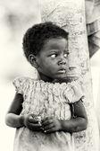 A Benin little girl wathes around — Stock Photo
