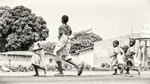 Benin children run forward for the dreams — Stock Photo