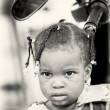 Stockfoto: Little Benin girl poses for camera