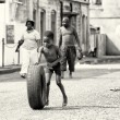 Stock Photo: Tire is typical toy for Ghanaichildren
