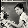 A Ghanaian woman sews using the sewing machine — Stock Photo