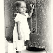 Stock Photo: Little Ghanaigirl stays near wall