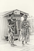 Two Ghanaian ladies pose and and wave for the camera — Stock Photo