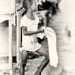 A young Ghanaian girl with a towel — Stock Photo