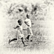 Ghanaiboy and girl play together in field — Stock Photo #11942977