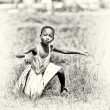 Little Ghanaian girl shows her dancing talent — Stock Photo