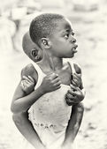One little Ghanaian girl carries her brother on her back — Photo