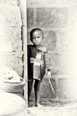 Little Ghanaian boy with a stick — Stock Photo