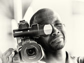A Ghanaian man with a camera — Stock Photo