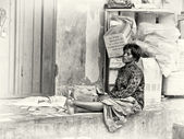 A Ghanaian woman sits and thinks of life — Stock Photo
