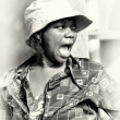 A Ghanaian woman in a hat screams — Stock Photo