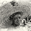 Ghanailady in incredible huge hat — Stockfoto #11961844