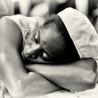 A Ghanaian lady sleeps after work — Stock Photo