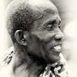 An old man from Ghana smiles with teeth — Stock Photo #11968995