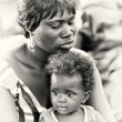Little Ghana baby on the hands of the mother — Stock fotografie
