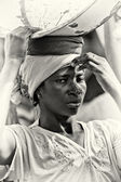 A young Ghanaian woman with a basin — Stock Photo