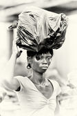 Ghanaian lady with a bag of trash over the head — Stock Photo