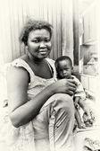 Little baby boy from Ghana and his mother — Stock Photo