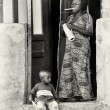 Ghanaian mother and son at their house — Stock Photo #11988613