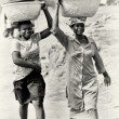 Two Ghanaian ladies with basins on their head — Stock Photo