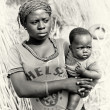 A Ghanaian mother carries her baby - Stock Photo