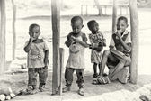 A group of Ghanaian children occupied by their own business — Stock Photo