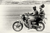 A Ghanaian couple on the motorbike — Stock Photo