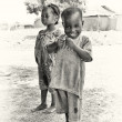 Smily little boy from Ghana and his sister — Stock Photo