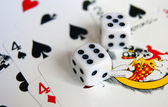Dice on playing cards — Stock Photo